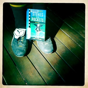 Soccer boots and book
